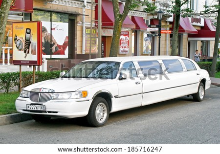 SOCHI, RUSSIA - JULY 19, 2009: White Lincoln Town Car limousine at the city street. - stock photo