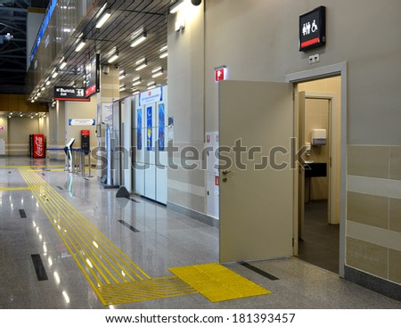 SOCHI, RUSSIA - MAR 5, 2014: Floorstanding tactile markings for the blind and toilet for people with disabilities at the railway station in Krasnaya Polyana for successful XI Winter Paralympic Games  - stock photo