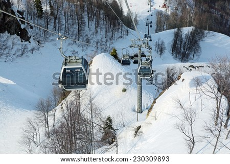 SOCHI, RUSSIA - MAR 26, 2014: Mountain lift to the ski resort Rosa Khutor in Krasnaya Polyana - popular center of skiing and snowboard, venue for the 2014 winter Olympics - stock photo