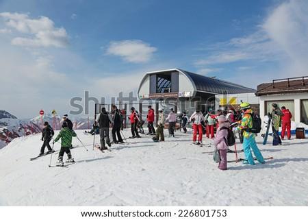 SOCHI, RUSSIA - MAR 26, 2014: The highest height Rosa Khutor Alpine ski Resort in Krasnaya Polyana - popular center of skiing and snowboard, venue for the 2014 winter Olympics - stock photo