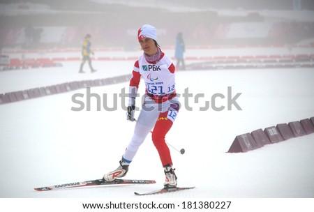 SOCHI, RUSSIA - March 11, 2014: Caroline Bisson (Canada) competes on Winter Paralympic Games  in Sochi. Biathlon, Women�¢??s 10 km, standing - stock photo