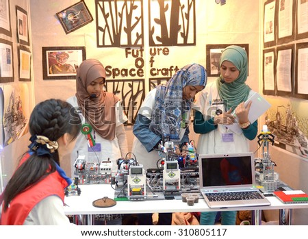 SOCHI, RUSSIA - November 21, 2014: Musulman girls competes at the robot Olympiad in Sochi . Here there was the World Robotic Olympiad 2014. It was attended by delegates from 47 countries. - stock photo