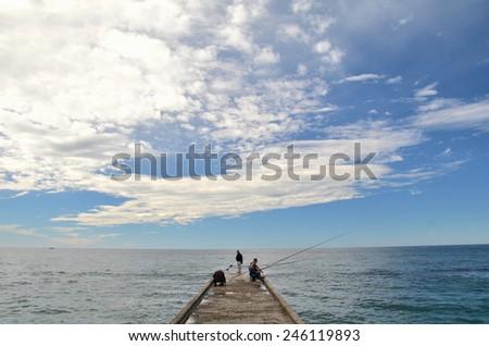 SOCHI, RUSSIA SEPTEMBER, 2014: View of fishermen on  beach in the Sochi, Russia - stock photo