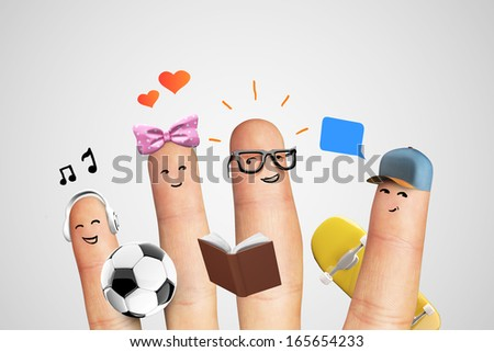 Social concept with fingers isolated on gray background - stock photo