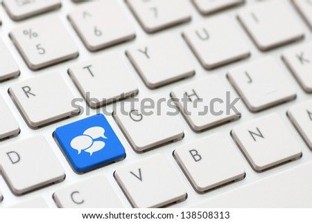 Social Media button on a keyboard with speech bubbles. - stock photo