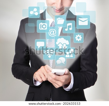 Social media concept - Business man using smart phone with social media icon set ,asia - stock photo