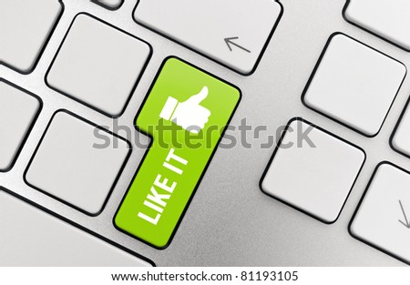 Social media concept - Like it with thumb up symbol on modern aluminum keyboard. - stock photo
