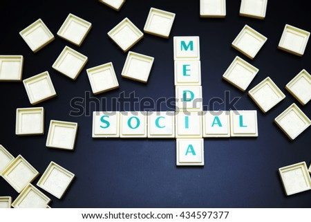 Social media concept. The words spelled by letters on black board background. Space for texts. - stock photo