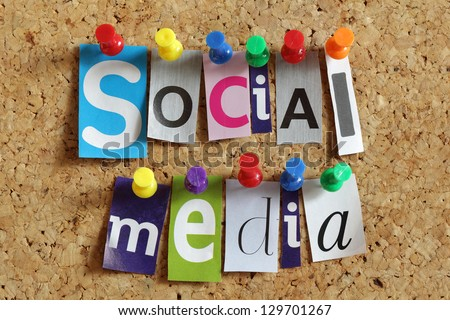 Social media from cutout newspaper headlines pinned to a cork bulletin board - stock photo