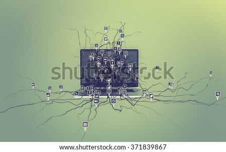 Social media icons set on the root growing out of laptop, concept - stock photo