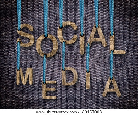 Social Media letters hanging strings with blue sackcloth background. - stock photo