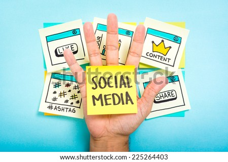 Social media on hand with blue background - stock photo