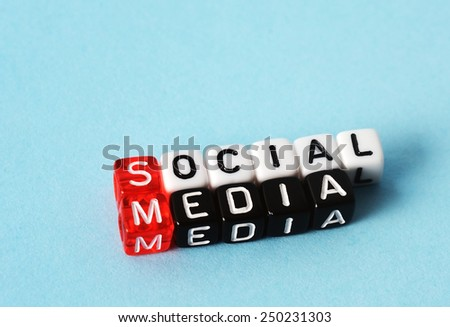 Social Media on red black  and  white  dices on  blue background - stock photo