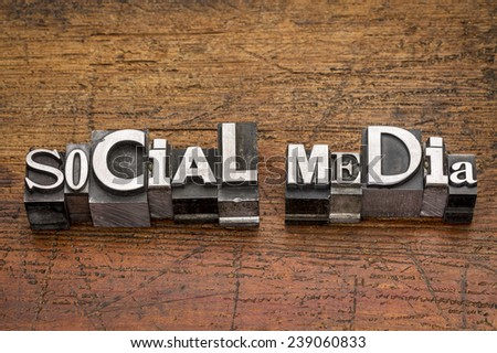 social media text  in mixed vintage metal type printing blocks over grunge wood - stock photo