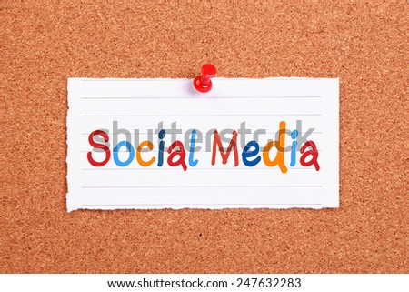 Social Media text written on note paper pinned on cork board. - stock photo