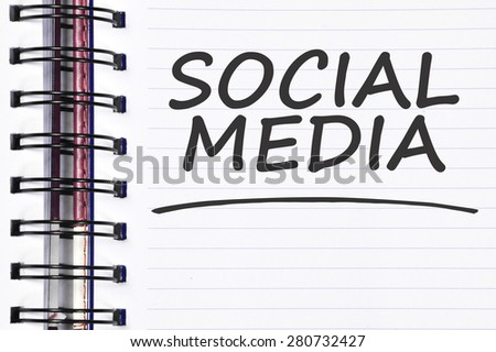 social media words on spring note book. - stock photo
