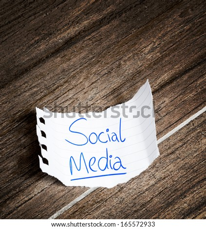 Social Media written on the paper on a wood background - stock photo