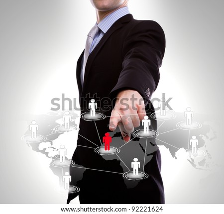 Social Network concept : business man point to social network and world map - stock photo