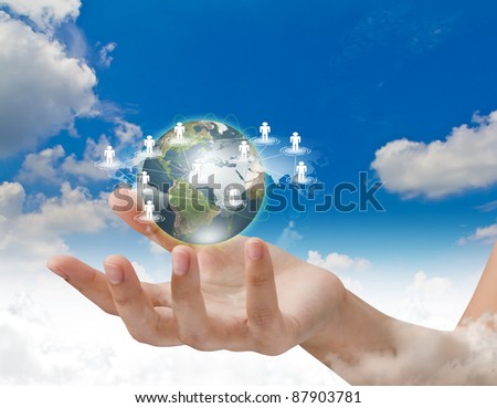 Social Network concept : hand hold earth of social network over blue sky - stock photo