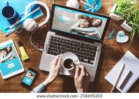 Social network user login, website mock up on computer screen, tablet and smartphone - stock photo