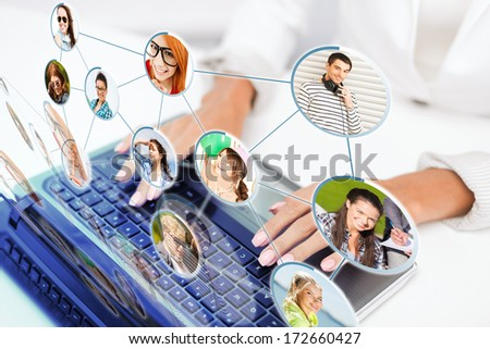 social networking, communication, technology and internet concept - businesswoman using her laptop computer - stock photo