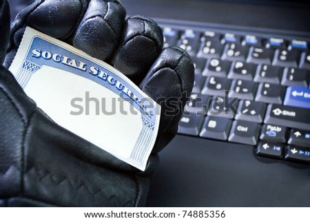 Social Security Card in hacker's hand, internet and identity theft - stock photo