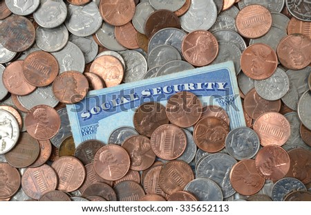 social security card laying in a pile of money - stock photo