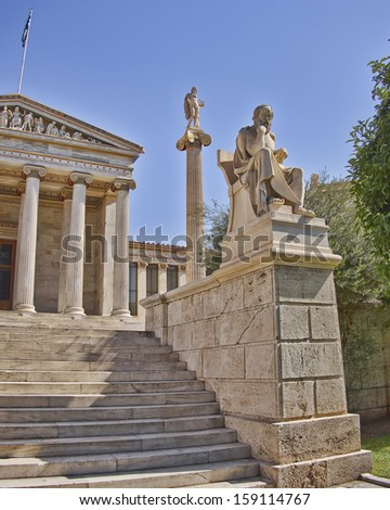 Socrates the philosopher and Apollo the god of arts in front of the national university of Athens, Greece - stock photo