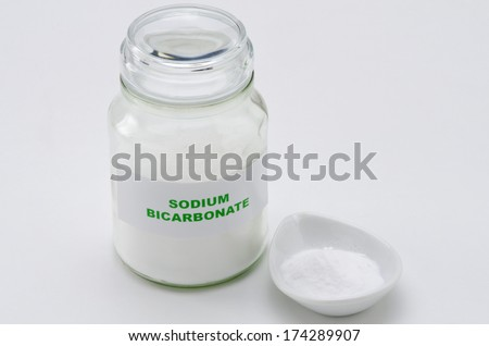 Sodium bicarbonate in a glass jar. White background. - stock photo