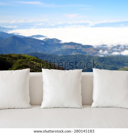 Sofa and empty background wall - stock photo