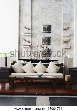 Sofa and table in a modern hotel lobby. - stock photo