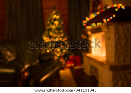Sofa, fireplace and decorated Christmas tree defocused background - stock photo