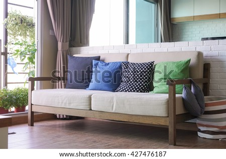 Sofa furniture interior decoration design in fabric and wooden style with brick white wall. - stock photo
