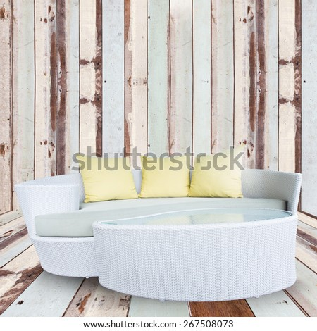 sofa furniture weave bamboo stick chair with yellow pillows on wooden wall - stock photo