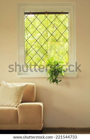 sofa in living room under window - stock photo