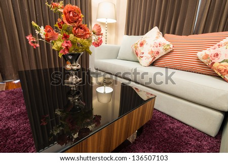 Sofa in living room with decorative flower - stock photo