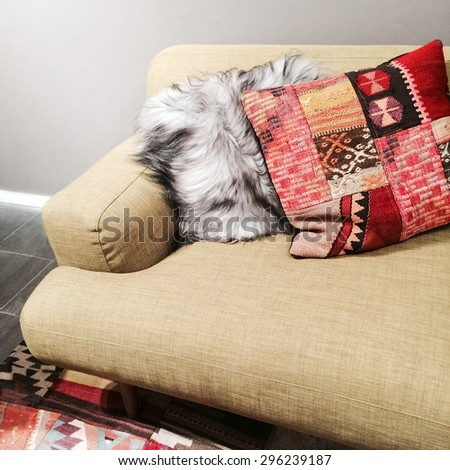 Sofa with fancy cushions in the living room. - stock photo