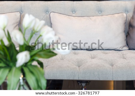 Sofa with pillows and flower Home Interior Decoration - stock photo