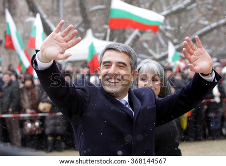 SOFIA, BULGARIA - JANUARY 22: Bulgarian President Rosen Plevneliev and his vice Margarita Popova greets crowd, during inauguration ceremony, Jan 22, 2012, Sofia, Bulgaria. - stock photo