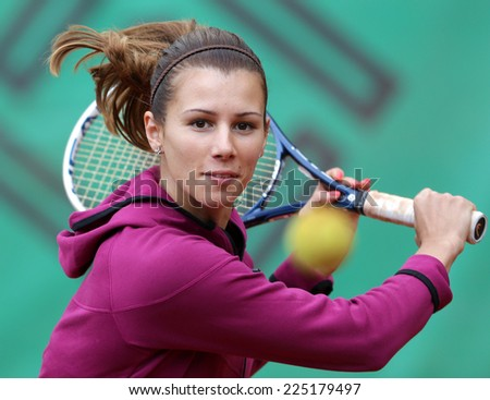 Sofia, Bulgaria - March 9, 2014: Bulgarian tennis player Tsvetana Pironkova partisipate in an open open tennis workout for children in the Borisova gradina park in Sofia.  - stock photo