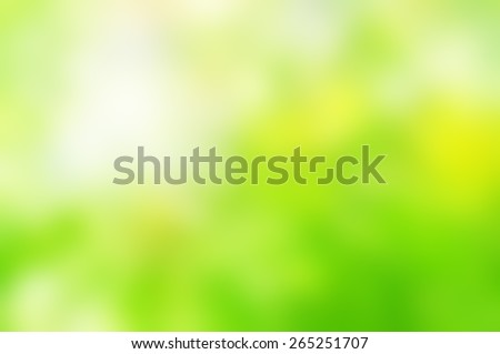 Soft  background blur from photograph of natural foliage.  Dappled and blended bright Spring greens with yellows and white sunlight. - stock photo
