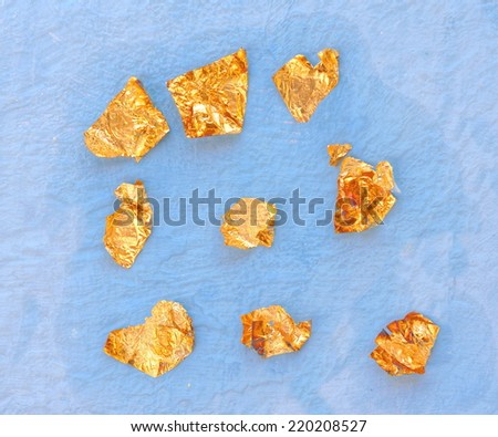 soft blue background with little pieces of gold attached - stock photo