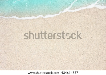 Soft blue ocean wave on sandy beach. Background. - stock photo