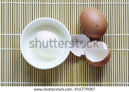 Soft boiled egg or Onsen egg on bamboo cheat - stock photo