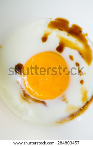 Soft boiled egg with soy sauce - stock photo