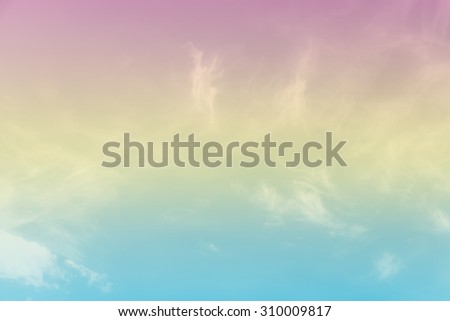 Soft cloud background with a pastel colored orange to blue gradient. - stock photo
