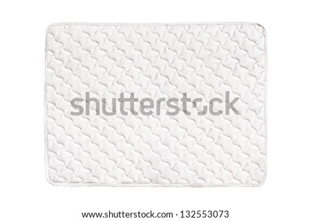 Soft comfortable quilted mattress isolated on white background - stock photo