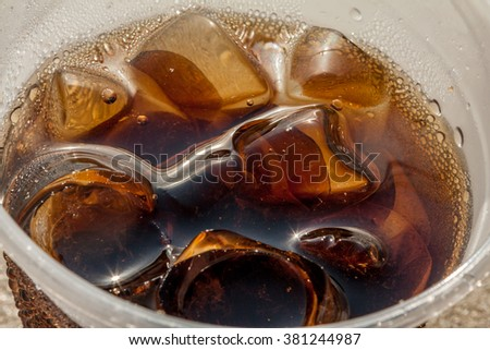 Soft Drink at beach with ice - stock photo