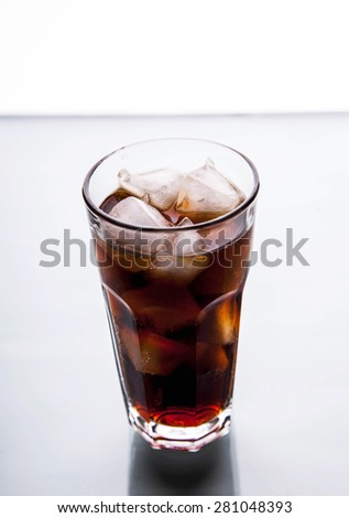 soft drinks. Cola glass with ice cubes on a white background - stock photo