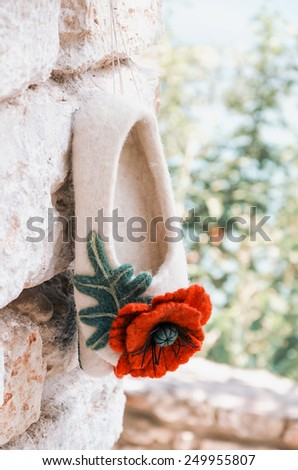 Soft Felted Slippers Hanging On The Wall - stock photo